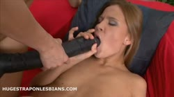 Abby has her tight pussy fucked by Lilian and a huge strapon